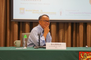 Professor Paul Yip listened attentively during the Q&A session